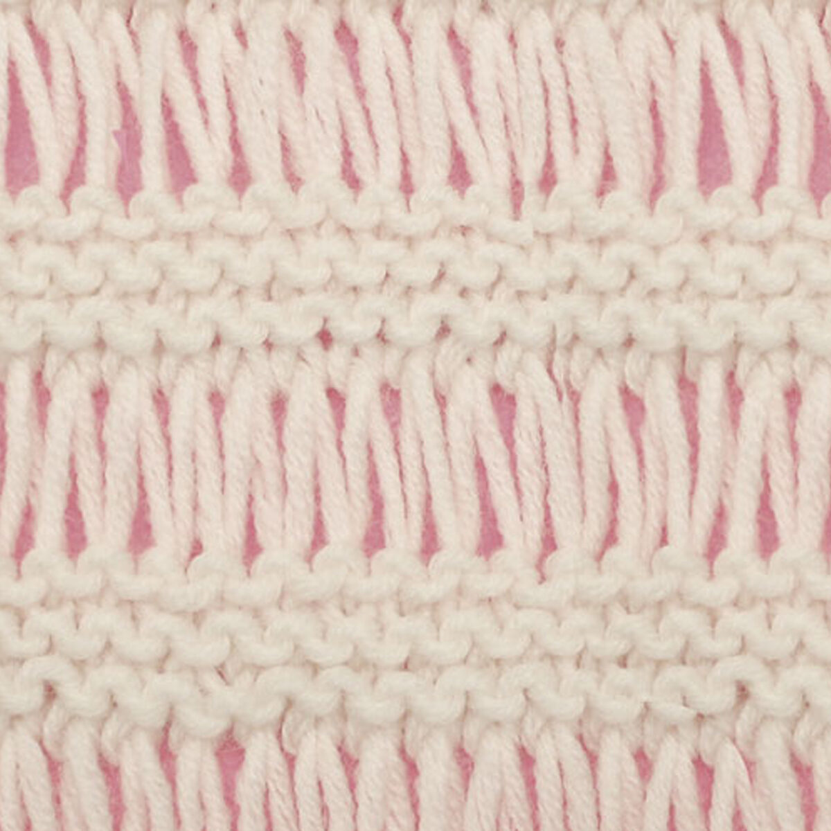 Drop Stitch Knitting Pattern texture in white color yarn atop pink background.