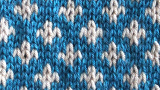 Fleur De Lys Stitch Knitting Pattern texture in blue and white colors of yarn.