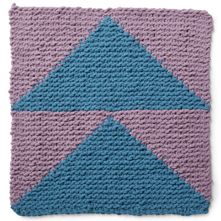 Knitted Square in the Flying Geese Design with shades of blue and purple yarn colors.