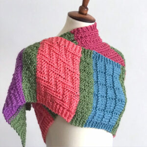 Colorful knitted scarf in different knit stitch textures on mannequin.