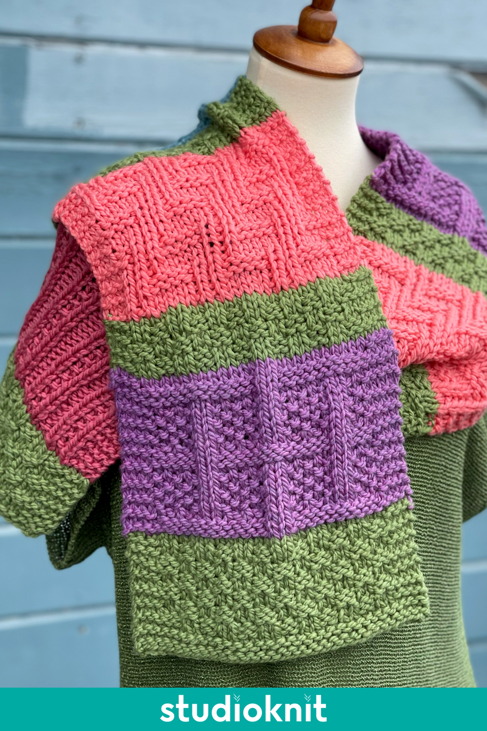 Color Block Knitted Scarf with Lattice Seed Stitch on manequin.