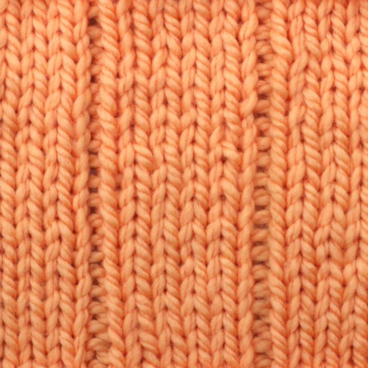 5x1 Flat Rib Stitch pattern in orange yarn color.