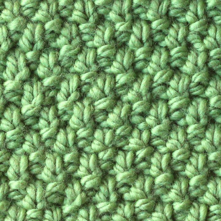 Irish Moss Knit Stitch pattern in green color yarn.